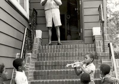 Getting ready to serenade the children on his block in Corona, Queens, 1970