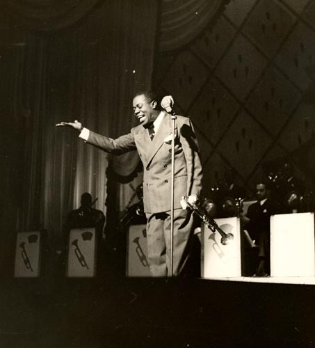 Taking bows on stage with his big band, late 1930s
