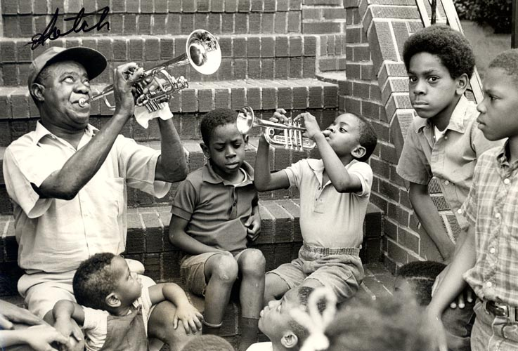Entertaining neighborhood children on the front steps of his Corona, Queens home, 1970