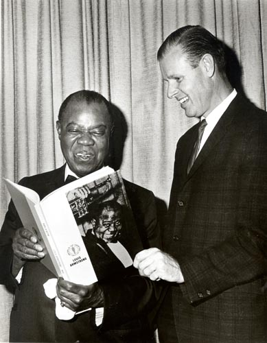 "Receiving a copy of the book, ""Louis Armstrong: People of Destiny,"" in 1967 (Photograph by Jack Bradley)"