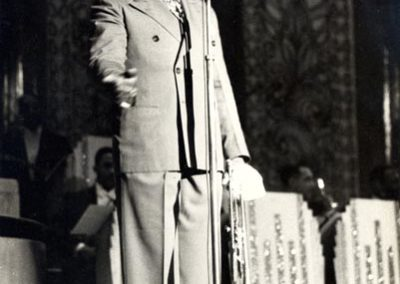 On stage with Luis Russell's Orchestra in the 1930s